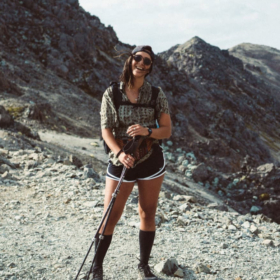 Elina Osborne standing on the pacific crest trail